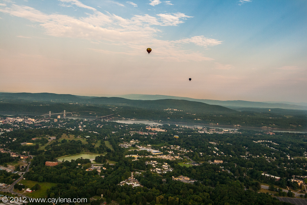 A balloon floats over the Hudson River this morning as part of the Dutchess County Balloon Festival in Poughkeepsie, NY. (July 7, 2012)