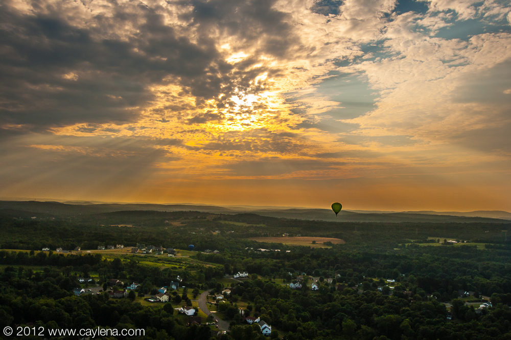 A balloon floats east into the sun this morning as part of the Dutchess County Balloon Festival in Poughkeepsie, NY. (July 7, 2012)
