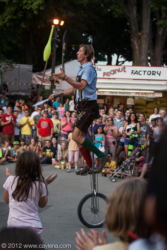 "Michael Hilby, an 18-year resident of Ithaca originally from Berlin, Germany, performs his show ""Skinny German Juggle Boy"" at the Dutchess County Fair in Rhinebeck Friday evening. (Aug. 24, 2012) Photo by CC Photo & Media, appeared on Newsday"