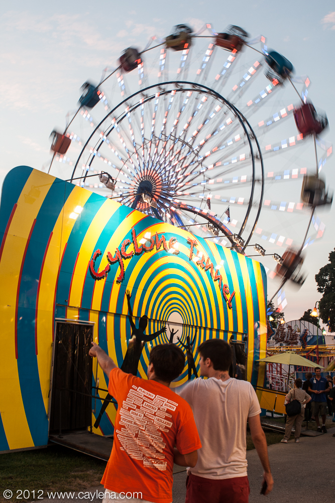 People consider risking the Cyclone Tunnel at the Dutchess County Fair in Rhinebeck. (Aug. 24, 2012) Photo by CC Photo & Media, originally appeared on Newsday