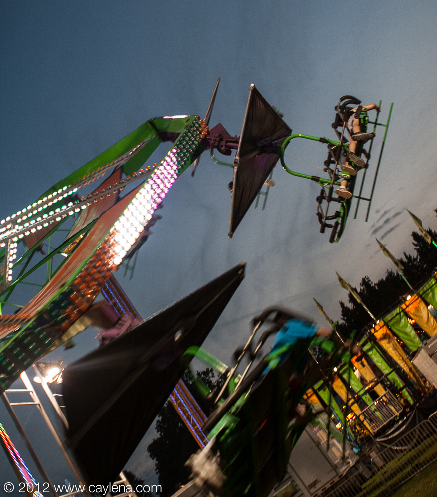 People attempt to fly on the Cliff Hanger ride at the Dutchess County Fair in Rhinebeck. (Aug. 24, 2012) Photo by CC Photo & Media, for Newsday