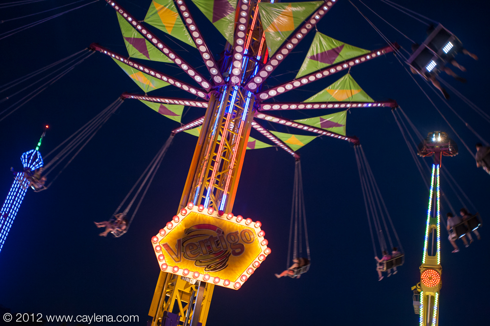 Riders spin around while doing up and down the vertigo inducing ride at the Dutchess County Fair in Rhinebeck. (Aug. 24, 2012) Photo by CC Photo & Media, for Newsday