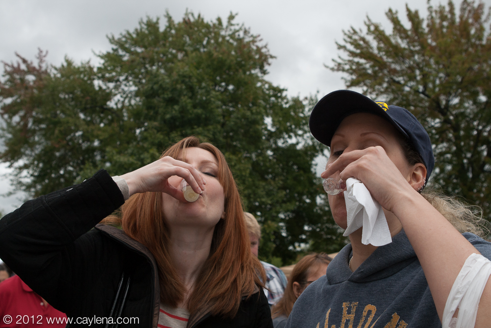 "People experience the Kiwanis Club's popular ""Garlic Shooters,"" a shot of garlic, water and lemon. (Sept. 29, 2012)"