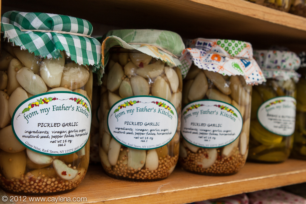 "The vendor, ""From My Father's Kitchen"" offers jars of pickled garlic at the Garlic Festival in Saugerties. (Sept. 29, 2012)"