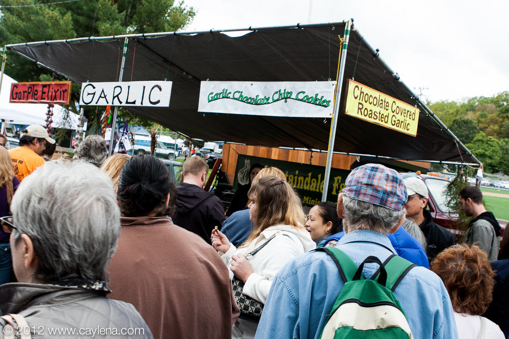 People crowd around the Mountaindal Farms stand at the Garlic Festival in Saugerties. (Sept. 29, 2012)