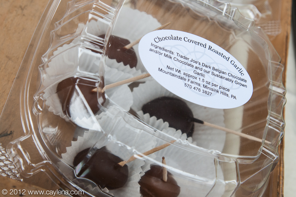 Mountaindal Farms of Minisink Hills, PA offers chocolate covered roasted garlic, as well as garlic chocolate chip coodies. A saleswoman at the festival Saturday said that this is only the second year they have offered these chocolate covered cloves, but that they seem to be a hit. (Sept. 29, 2012)