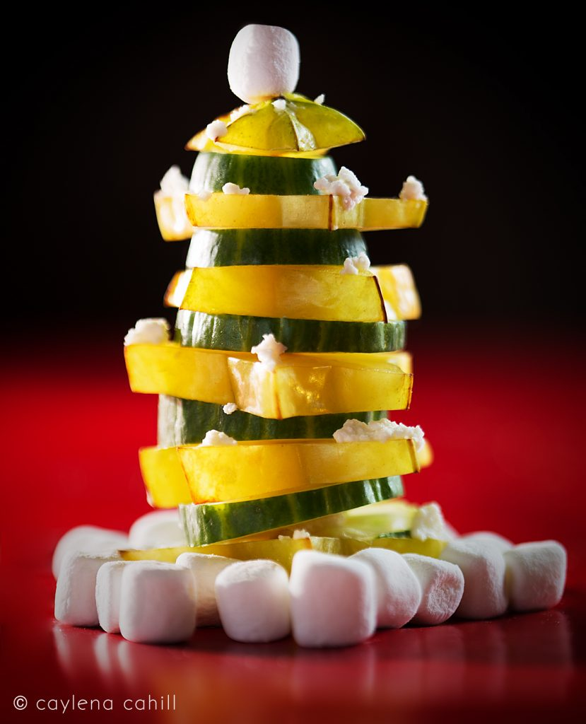 festive and fun food. christmas tree made from star fruit and cucumbers