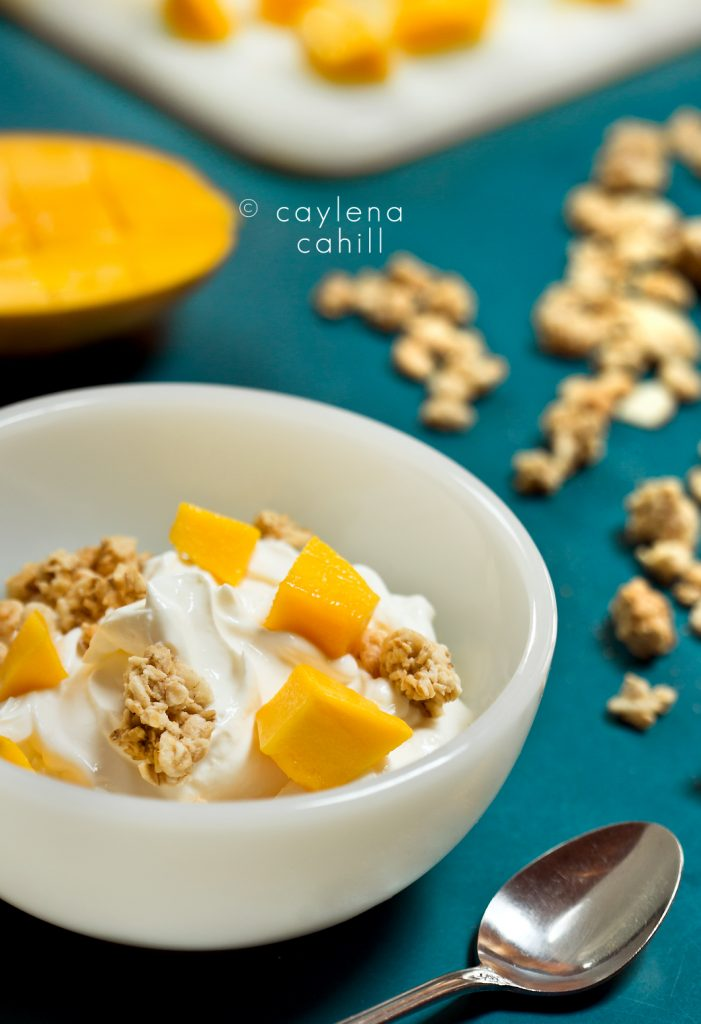 Yogurt and mango parfait with granola, by Hudson Valley food photographer, Caylena Cahill