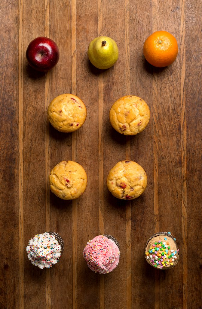 Statistics of Weight in America, as visualized by fruit, muffins and cupcakes.